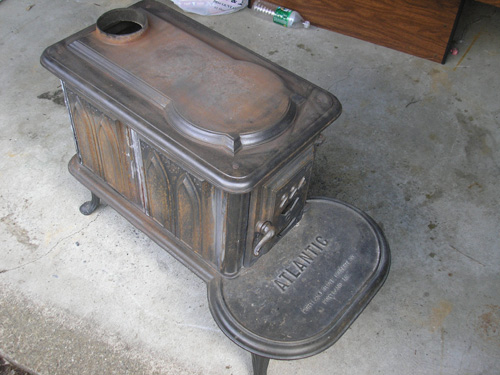 This is a picture of the wood stove during the sanding process. - How To Restore A Wood Stove